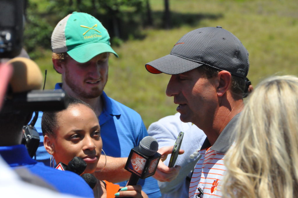 clemson football coach dabo swinney talking to reporters at The Reserve media day